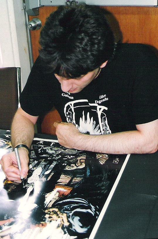 Neil Gaiman signing my poster